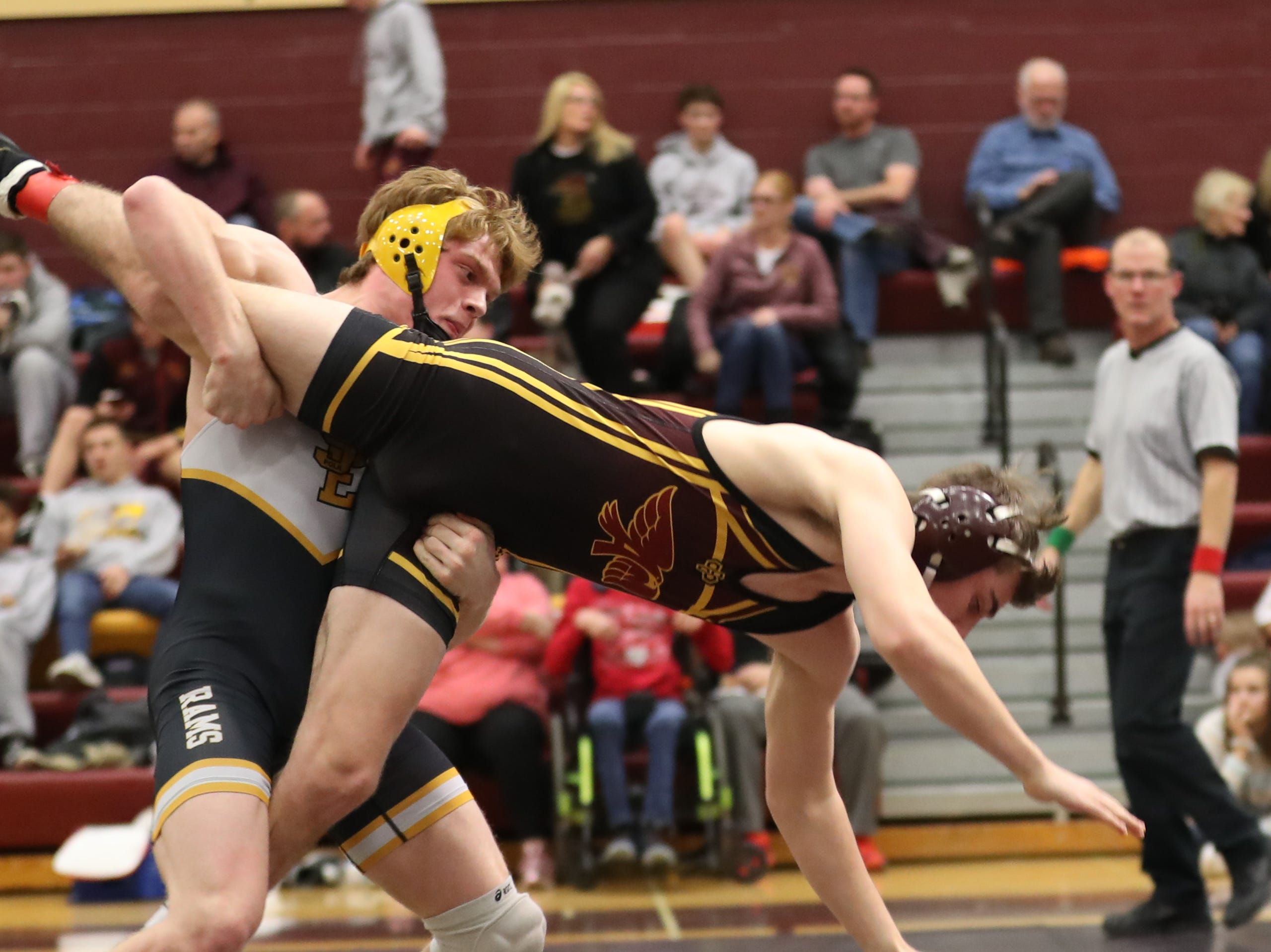Dec. 4, 2018; Des Moines, IA  USA; Nathan Marchand (Southeast Polk) over Wyatt Carl (Ankeny) (MD 13-4) at Des Moines Lincoln High School. The Rams beat the Hawks 54-14.
