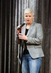 """Jodi Marti speaks at the Des Moines Storytellers' """"War Stories: Battles on the frontline and back home"""" at the Tea Room in Des Moines on Thursday, Dec. 6, 2018."""