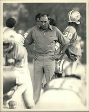 Darryl Rogers as the Detroit Lions head coach.