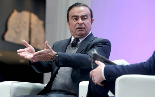 Carlos Ghosn, CEO of Nissan Motor Co., Ltd, on stage during a discussion about electric cars and autonomous vehicles during the 2017 North American International Auto Show held at Cobo Center in Detroit in January 2017.