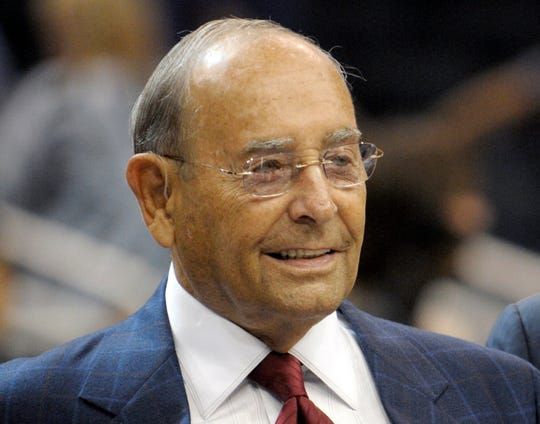 In this Oct. 10, 2010 photo, Richard DeVos, Orlando Magic owner and Amway Inc. co-founder, smiles after welcoming fans to the new Amway Center before a preseason NBA basketball game against the New Orleans Hornets in Orlando, Fla. on Oct. 10, 2010. DeVos, the billionaire father-in-law of Education Secretary Betsy DeVos, died Thursday, Sept. 6, 2018. He was 92. (
