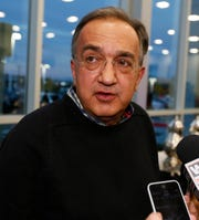 Fiat and Chrysler CEO Sergio Marchionne talking to members of the media during grand opening of Suburban Chrysler Jeep Dodge in Farmington Hills on Friday, October 10, 2014.