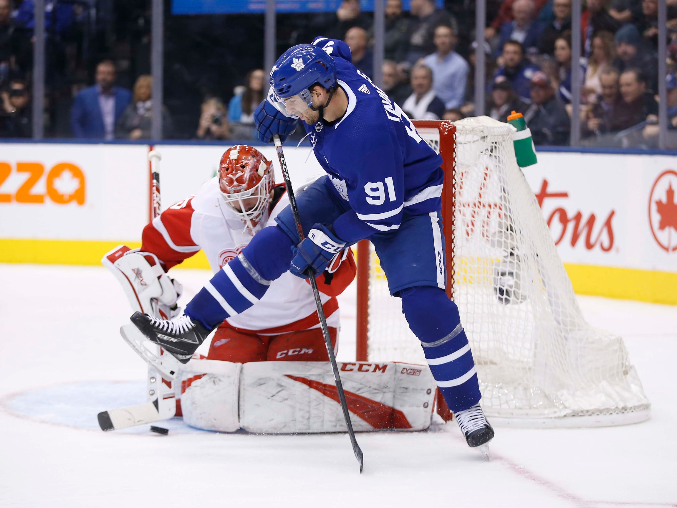 Toronto Maple Leafs forward John Tavares directs a puck on Detroit Red Wings goaltender Jonathan Bernier during the second period at Scotiabank Arena, Dec. 6, 2018 in Toronto, Ontario, Canada.