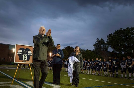 Pete Dawkins attends a Cranbrook-Kingswood game for the retirement of his jersey on Sept. 28, 2018. Also pictured, from left: Aimeclaire Roche, director of schools, and Noel Dougherty, head of upper school.