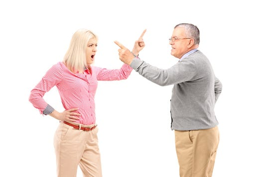 An Agry Female And Mature Man Arguing