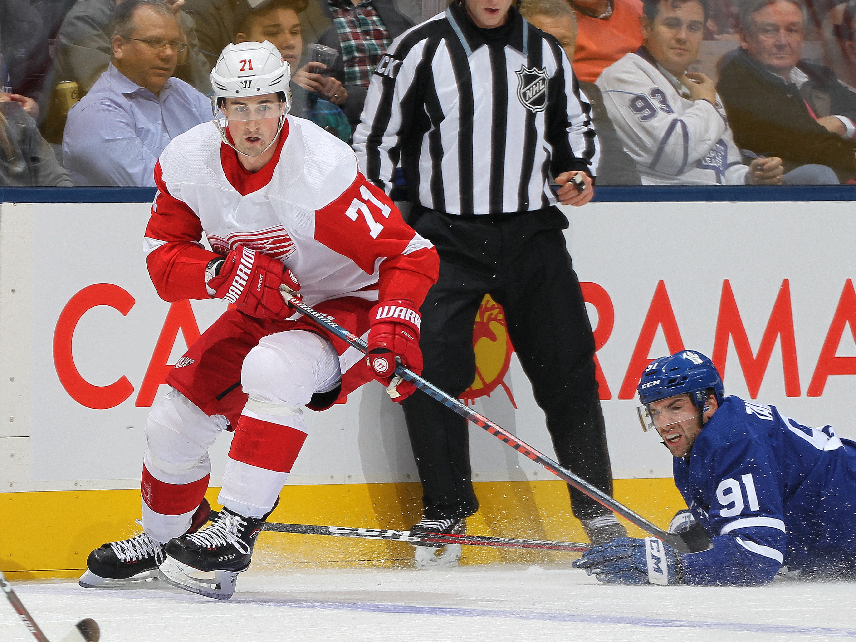 Detroit Red Wings' Dylan Larkin skates against John Tavares of the Toronto Maple Leafs at Scotiabank Arena on Dec. 6, 2018 in Toronto, Ontario, Canada.