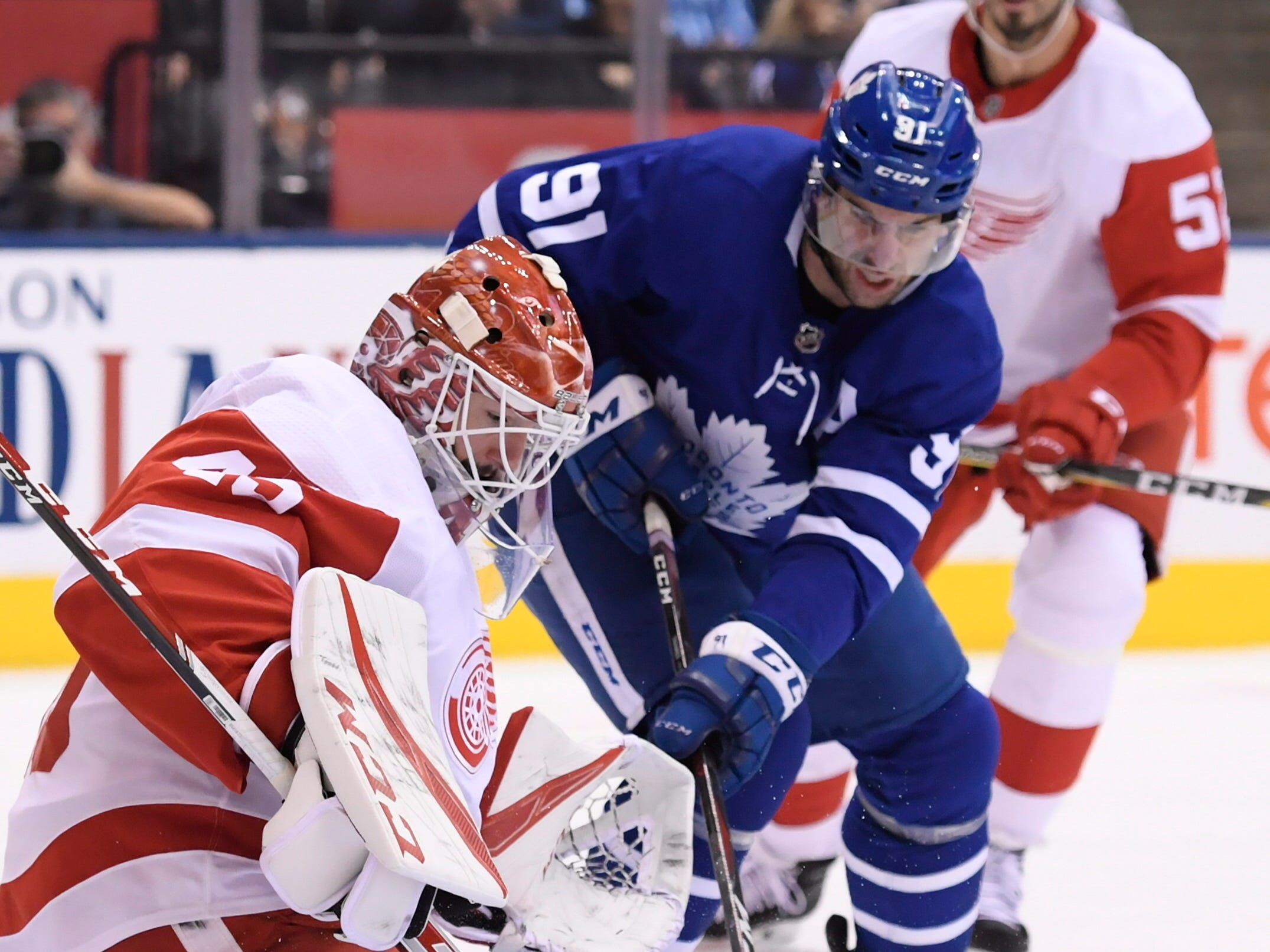 Toronto Maple Leafs center John Tavares is stopped by Detroit Red Wings goaltender Jonathan Bernier as Red Wings defenseman Jonathan Ericsson watches during the first period Thursday, Dec 6, 2018, in Toronto.