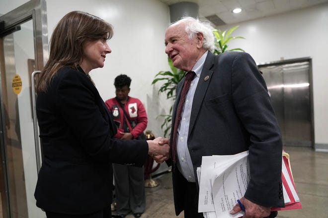 Mary Barra, CEO of General Motors, shakes hands with Rep. Sandy Levin (D-MI) after a meeting with members of the Congressional Michigan delegation on Capitol Hill, December 6, 2018 in Washington, DC.