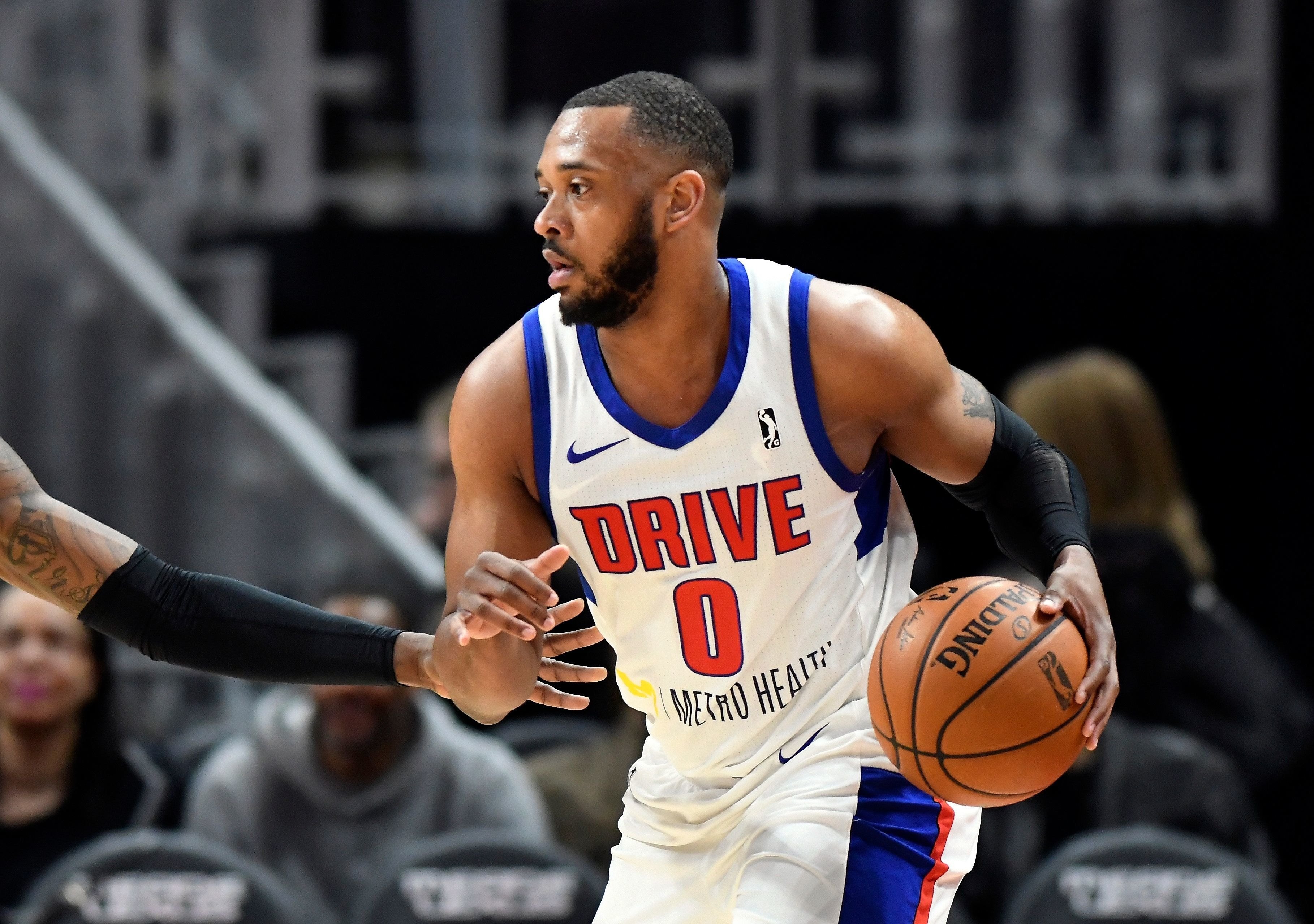 In a photo from Feb. 28, 2018, Grand Rapids Drive forward Zeke Upshaw looks to pass during a basketball game in Detroit. Upshaw, the Detroit Pistons developmental player who collapsed on the court during a NBA G League game in Michigan has died.