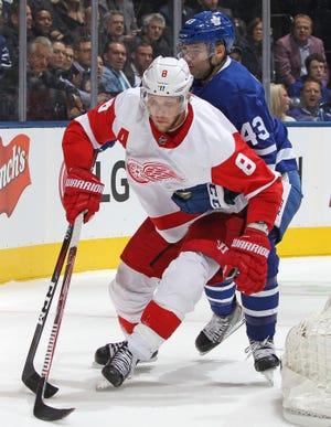 Detroit Red Wings' Justin Abdelkader skates against Nazem Kadri of the Toronto Maple Leafs at Scotiabank Arena, Thursday, Dec. 6, 2018.