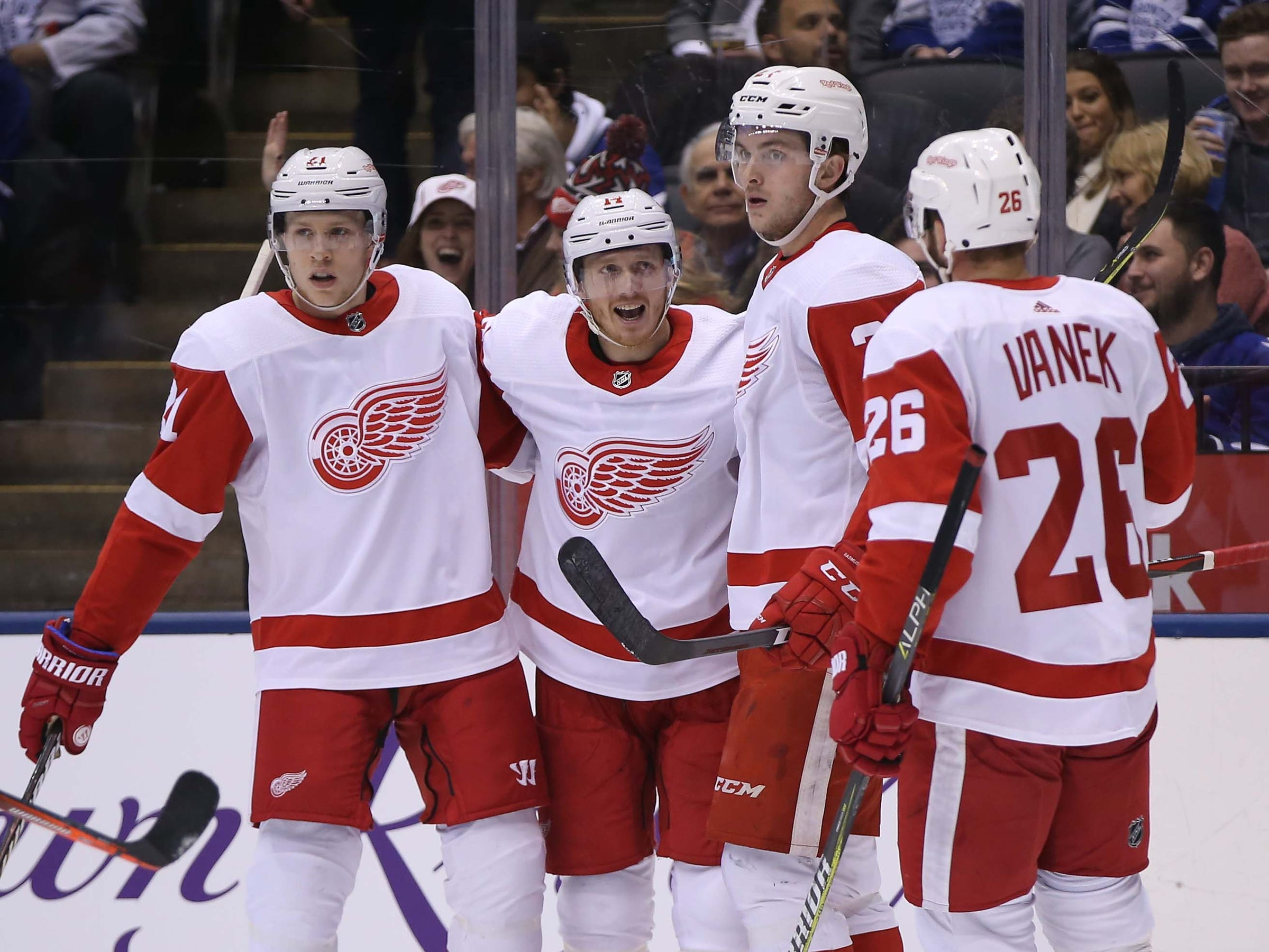 Detroit Red Wings forward Gustav Nyquist (center) celebrates his goal against the Toronto Maple Leafs during the first period at Scotiabank Arena, Dec. 6, 2018 in Toronto, Ontario, Canada.