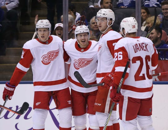 Detroit Red Wings forward Gustav Nyquist (center) celebrates his goal  against the Toronto Maple c77a1ef92