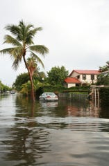"In 2009, a residential street in Miami's South Beach is flooded after a storm left 8-9 inches of water. With the film ""From Paris to Pittsburgh."""