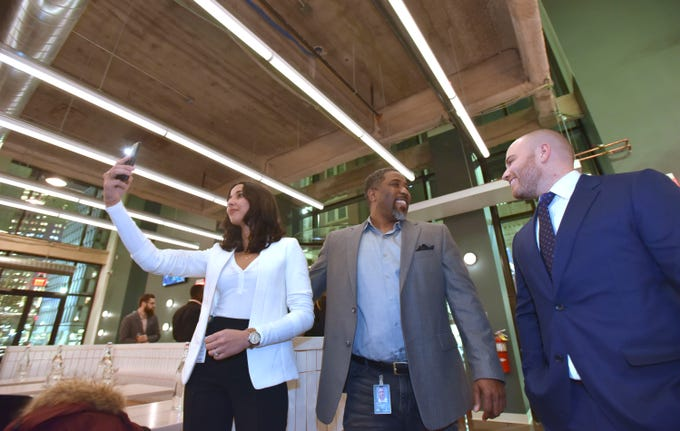 Galley Group co-founder Ben Mantica, right, of Pittsburgh welcomes Bedrock co-workers Houda Jarid, left, construction engineer, and Bryan Waldron, business development director, both of Detroit, to the Fort Street Galley food hall soft opening, Thursday night, Dec. 6, 2018.