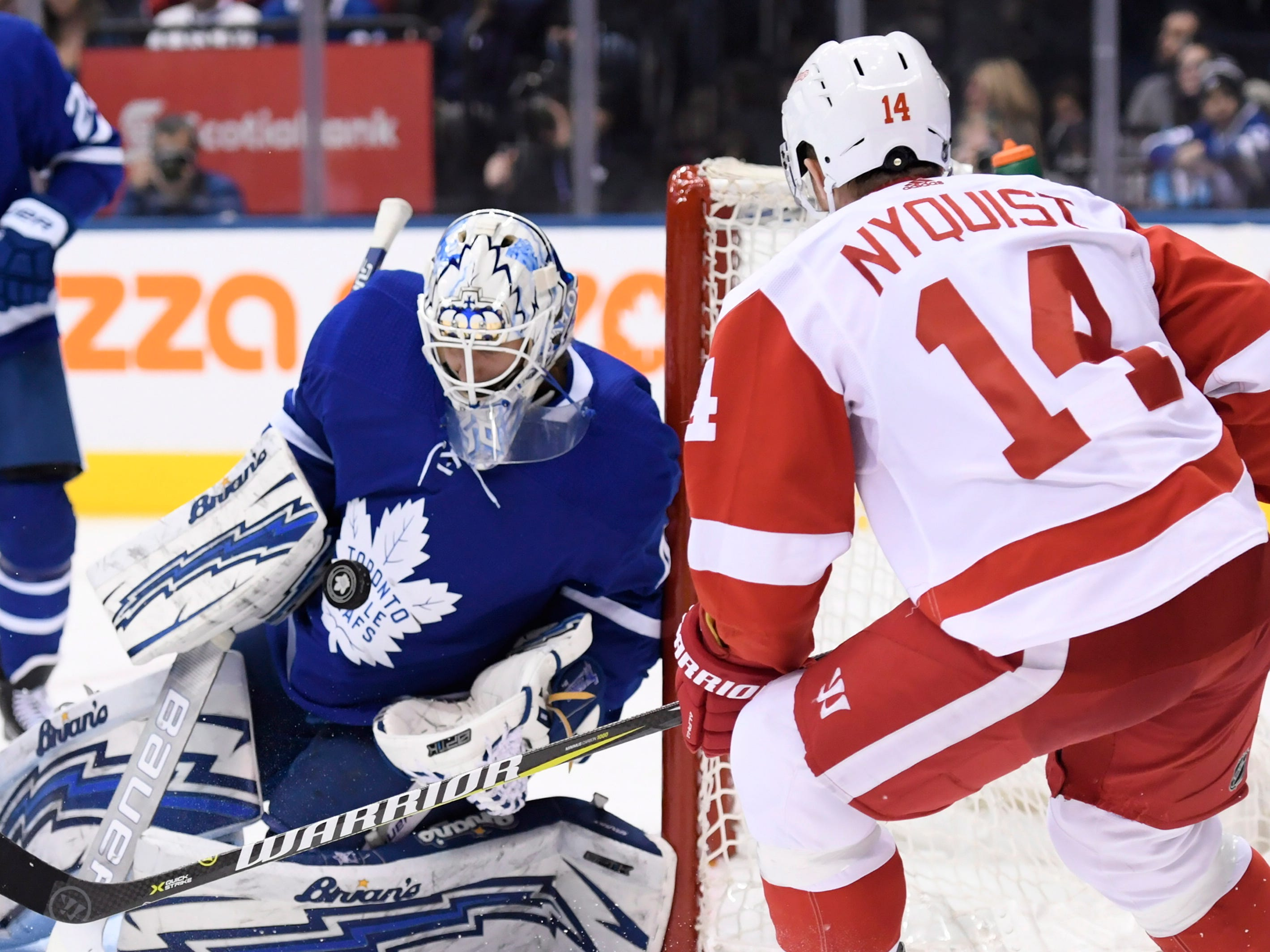 Maple Leafs goaltender Garret Sparks makes a save on Red Wings right wing Gustav Nyquist during the third period.