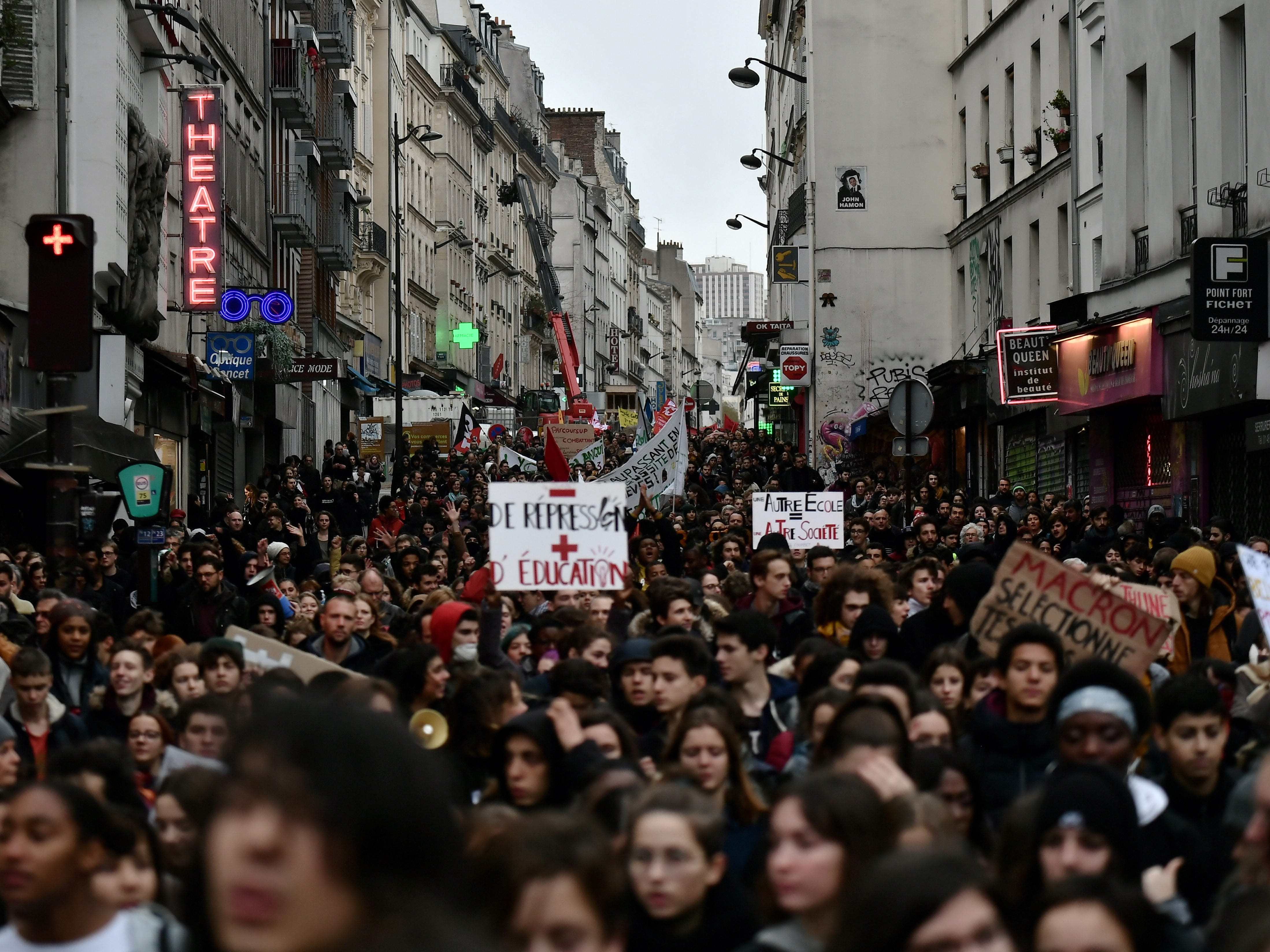 High school students hold banners during a demonstration march from Stalingrad to de la Republique in Paris, on Dec. 7, 2018 in protest of education reforms that include stricter university entrance requirements.