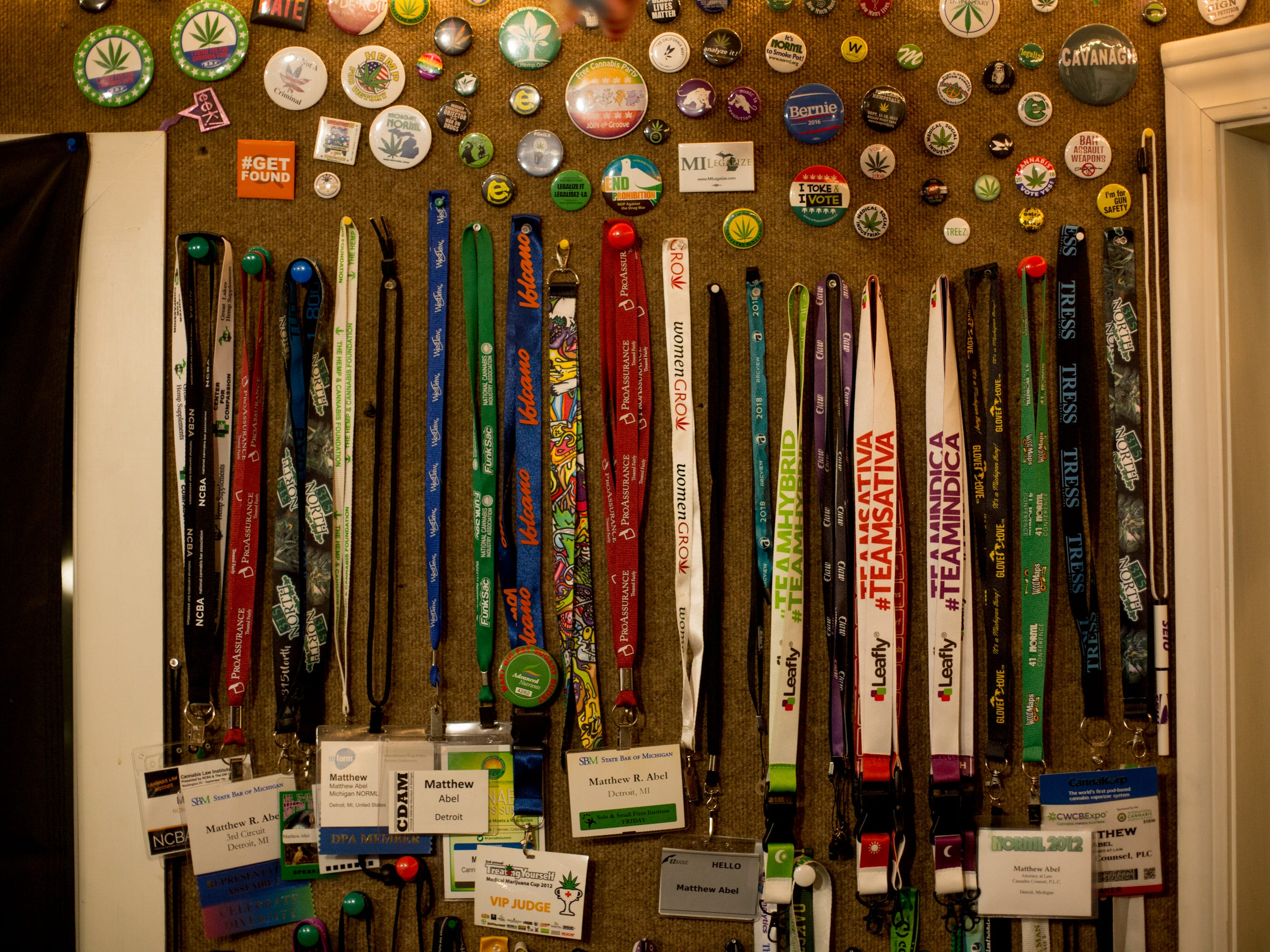 Lanyards attached to Matthew Abel's name hang on the wall.