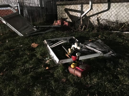 Mickey Mouse toy among children's items in yard of home where 2-year-old boy lost his life in house fire early Friday morning on Mackay and Lawley Streets on Detroit/Hamtramck border