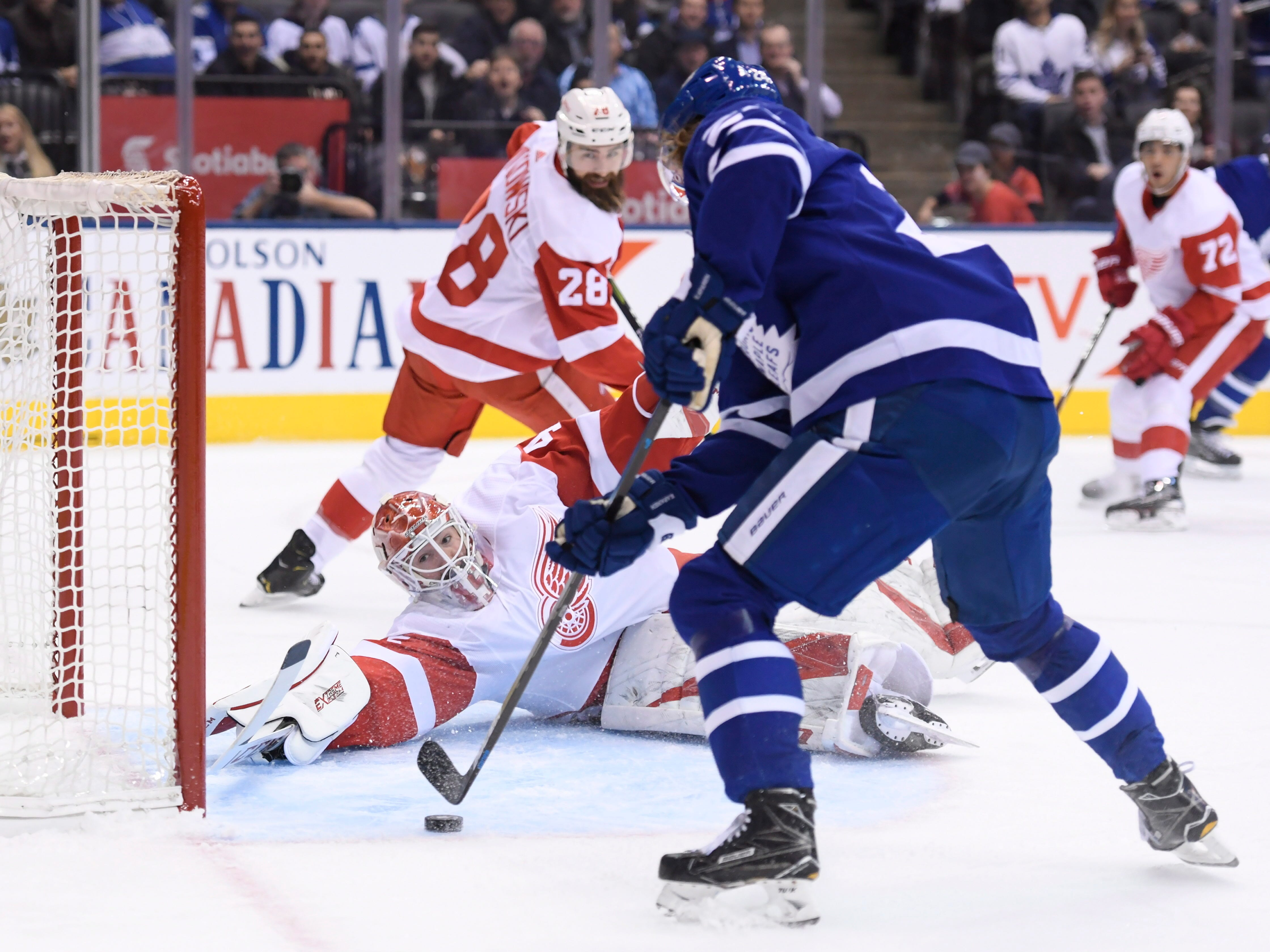 Maple Leafs right wing Kasperi Kapanen scores past Red Wings goaltender Jonathan Bernier during the first period.