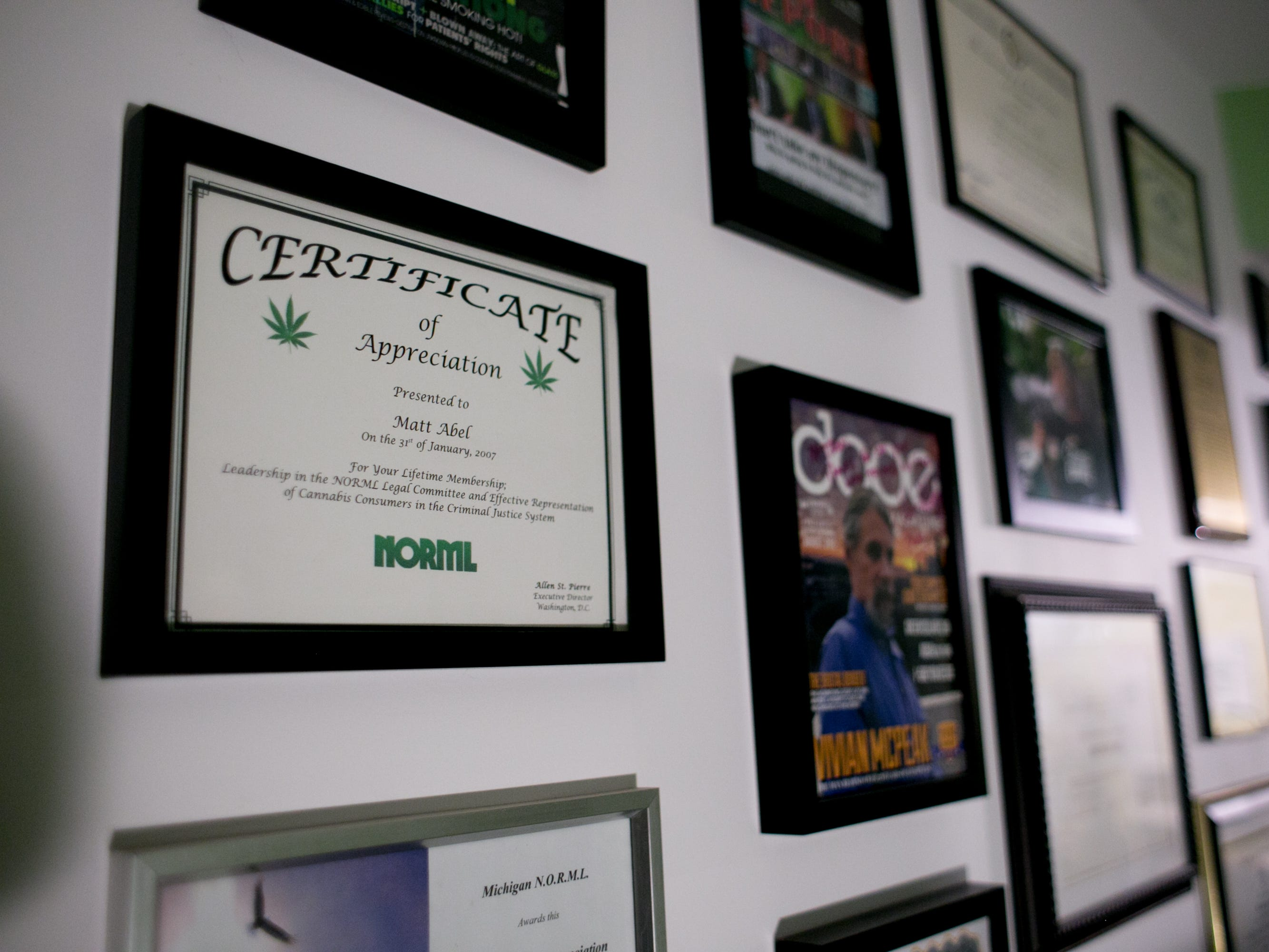 Accolades are displayed on the wall at a party celebrating the first day of legal recreational marijuana use, at the Cannabis Counsel on the east side of Detroit.