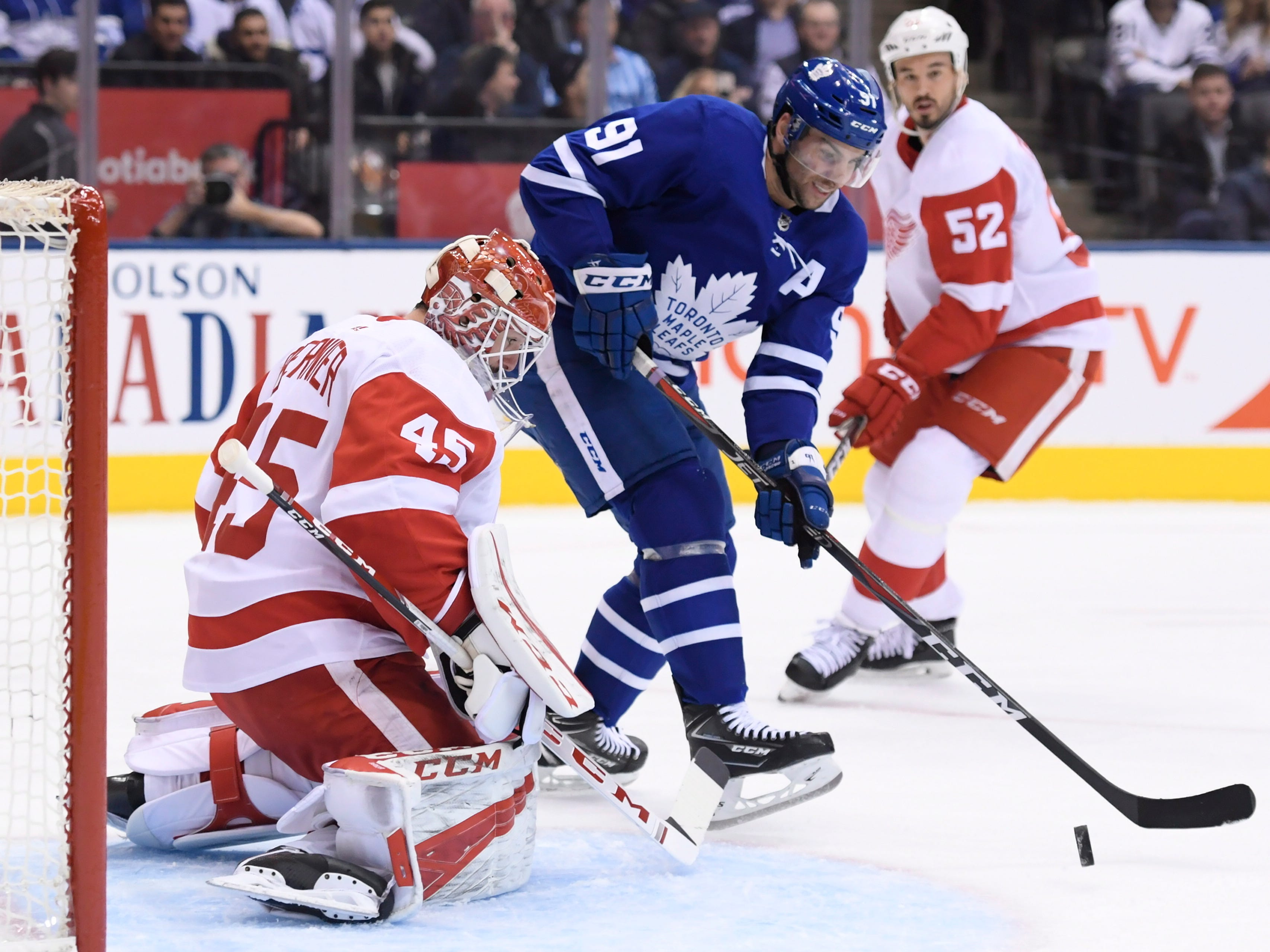 Maple Leafs center John Tavares is stopped by Red Wings goaltender Jonathan Bernier as defenseman Jonathan Ericsson moves in during the first period.
