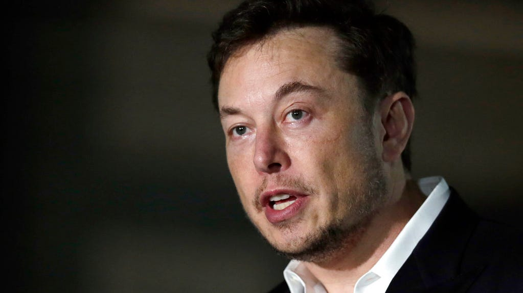 "FILE - In this June 14, 2018, file photo, Tesla CEO Elon Musk speaks at a news conference in Chicago. Tesla Inc. CEO Elon Musk told Lesley Stahl of CBS's ""60 Minutes"" that it's ""possible we would be interested"" in one of GM's soon-to-be-empty plants ""if (GM) were to sell a plant or not use it."""