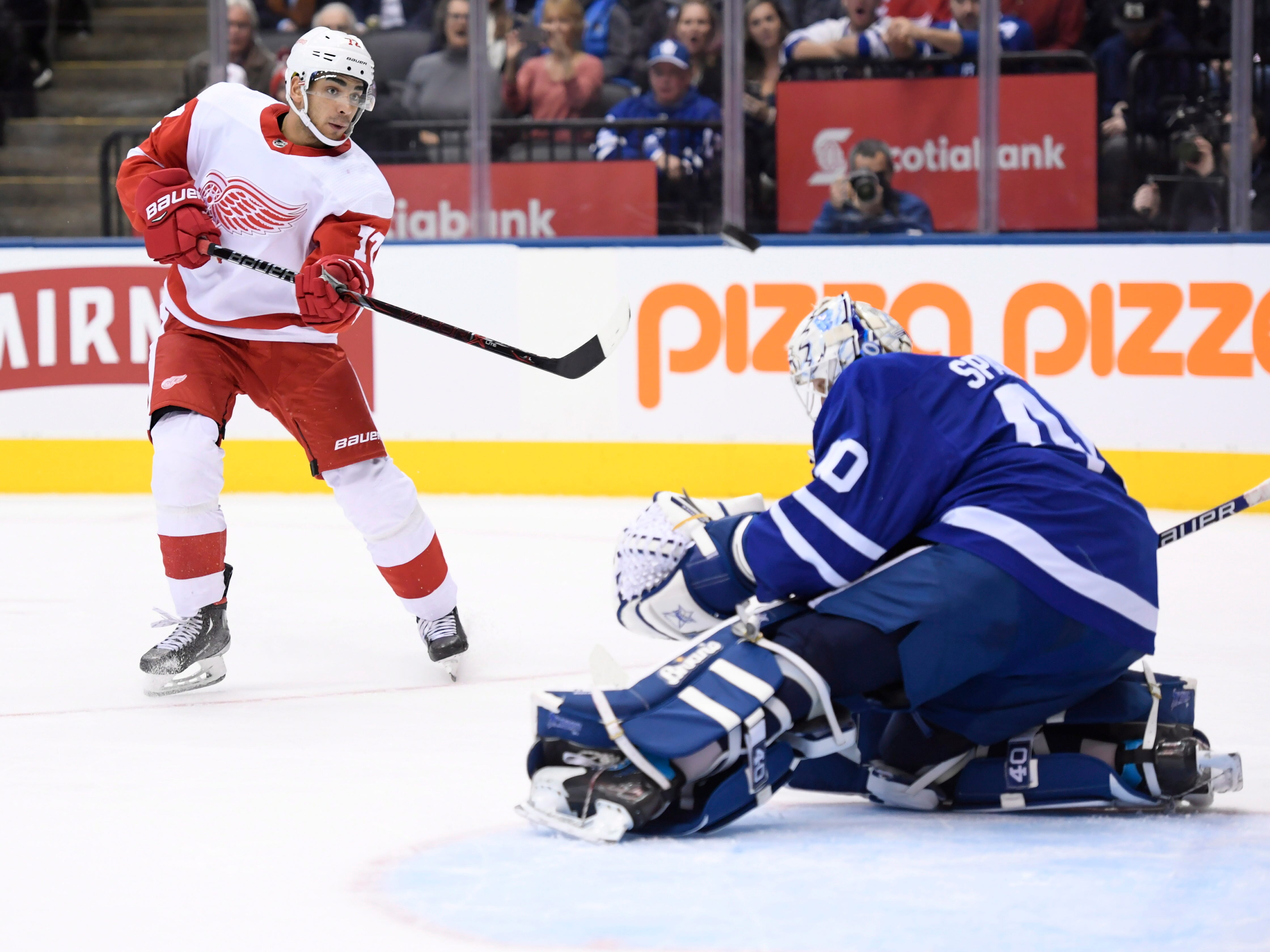 Maple Leafs goaltender Garret Sparks makes a save on Red Wings center Andreas Athanasiou during the third period.