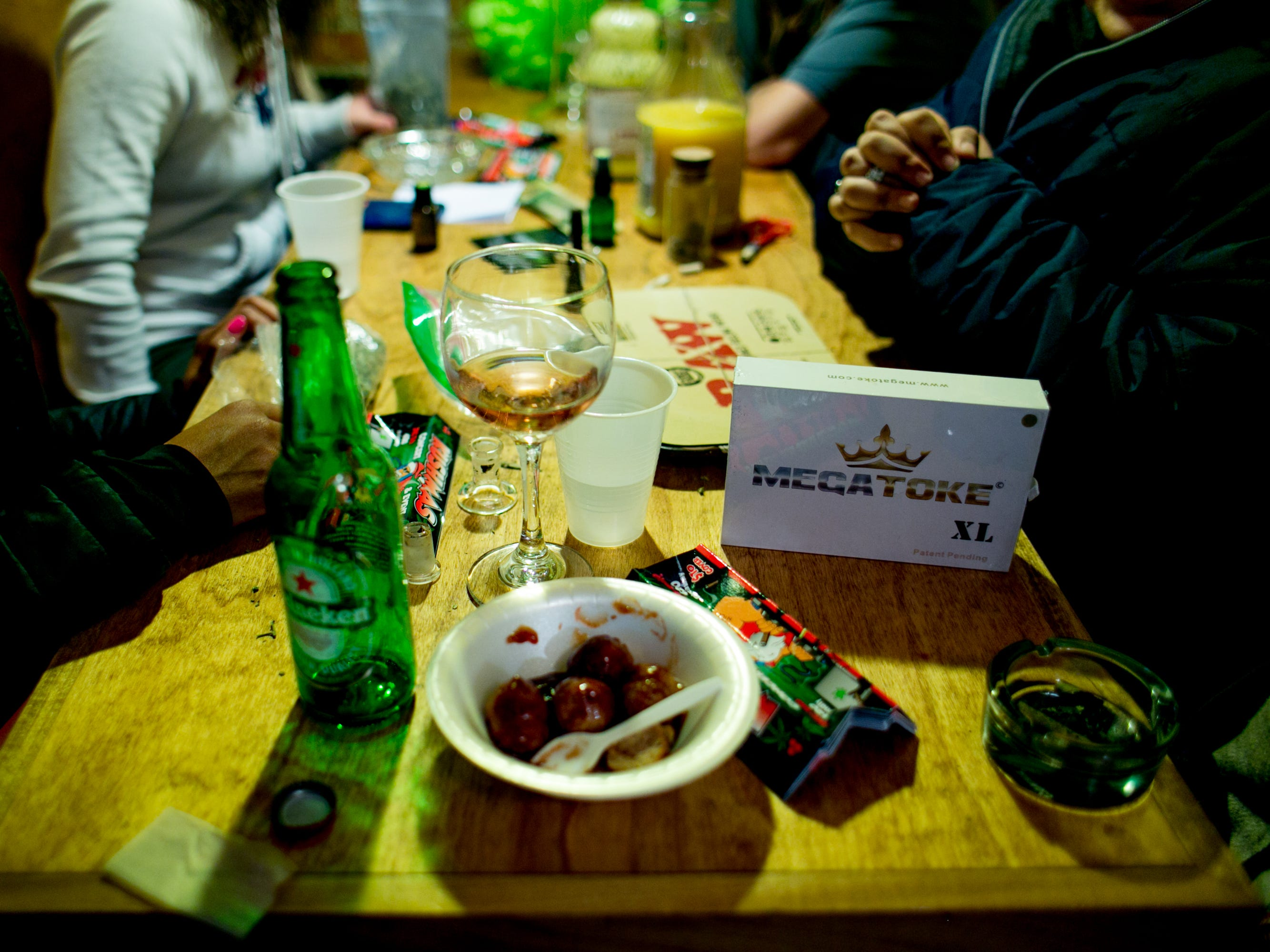 Pot paraphernalia is seen at the party.