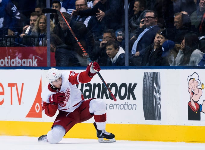 Red Wings center Dylan Larkin reacts after scoring in overtime against the  Maple Leafs in Toronto on Thursday, Dec. 6, 2018. The Red Wings win, 5-4.