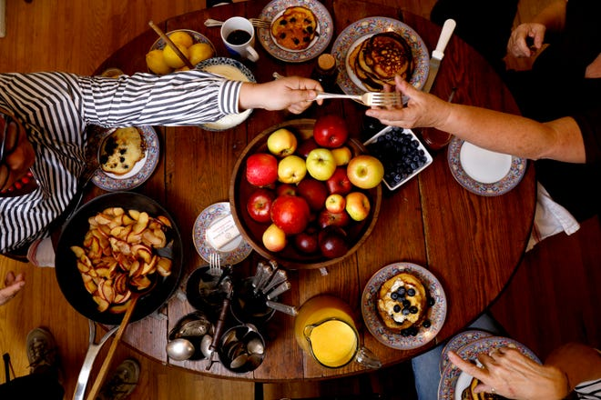 A pancake party with whole wheat pancakes, blueberry-cornmeal pancakes, lemon ricotta, brown sugar syrup, heirloom apples, and coffee, photographed on Sunday, Nov. 18, 2018. (Christina House/Los Angeles Times/TNS)