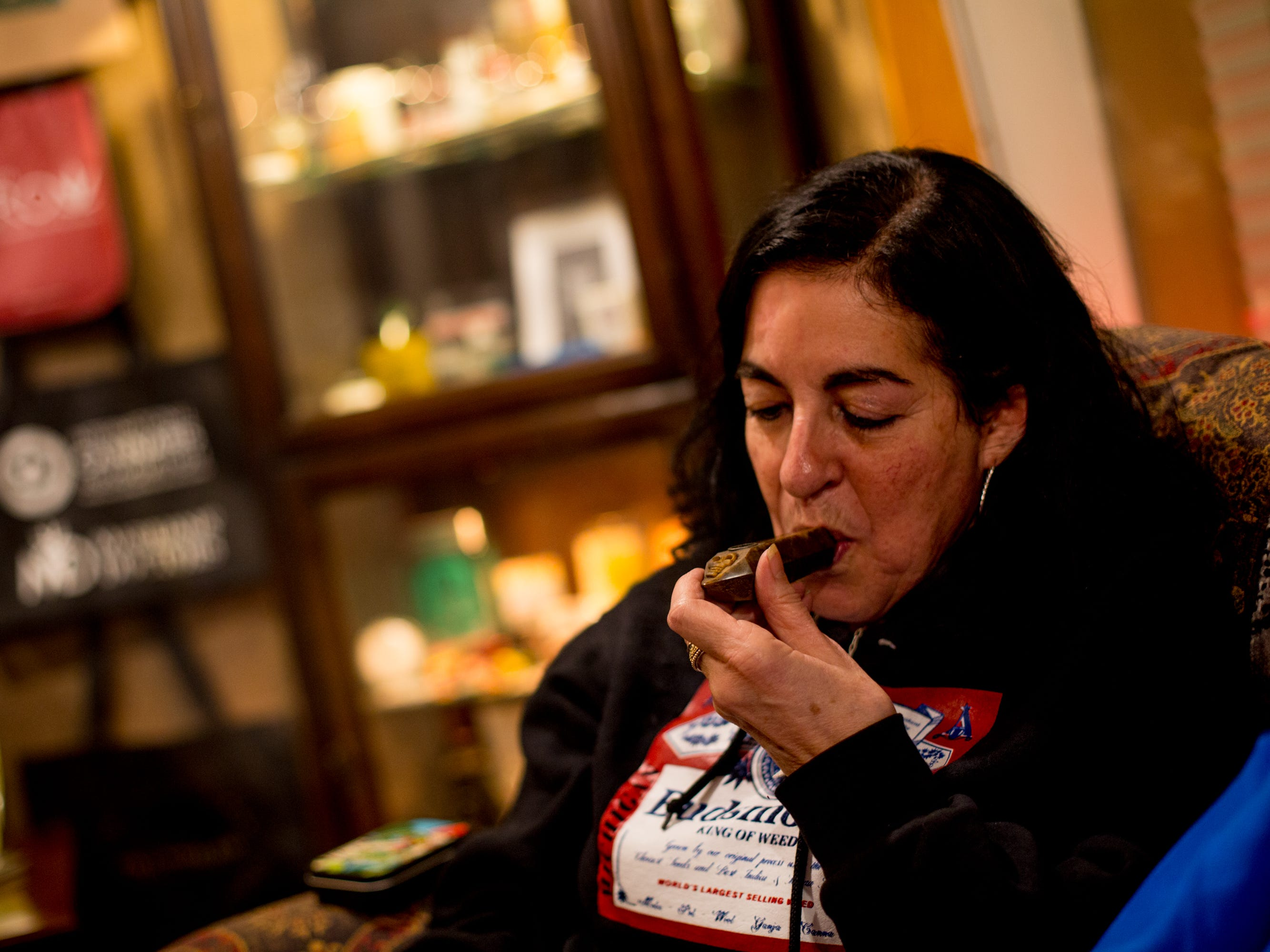 Debra Young, 61, of Ferndale smokes pot at the party.