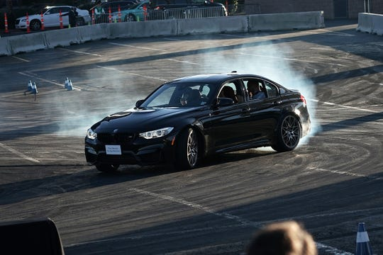 A driver demonstrates drifting with a BMW M5 during CES 2018 in January in Las Vegas, a week before Detroit's auto show.