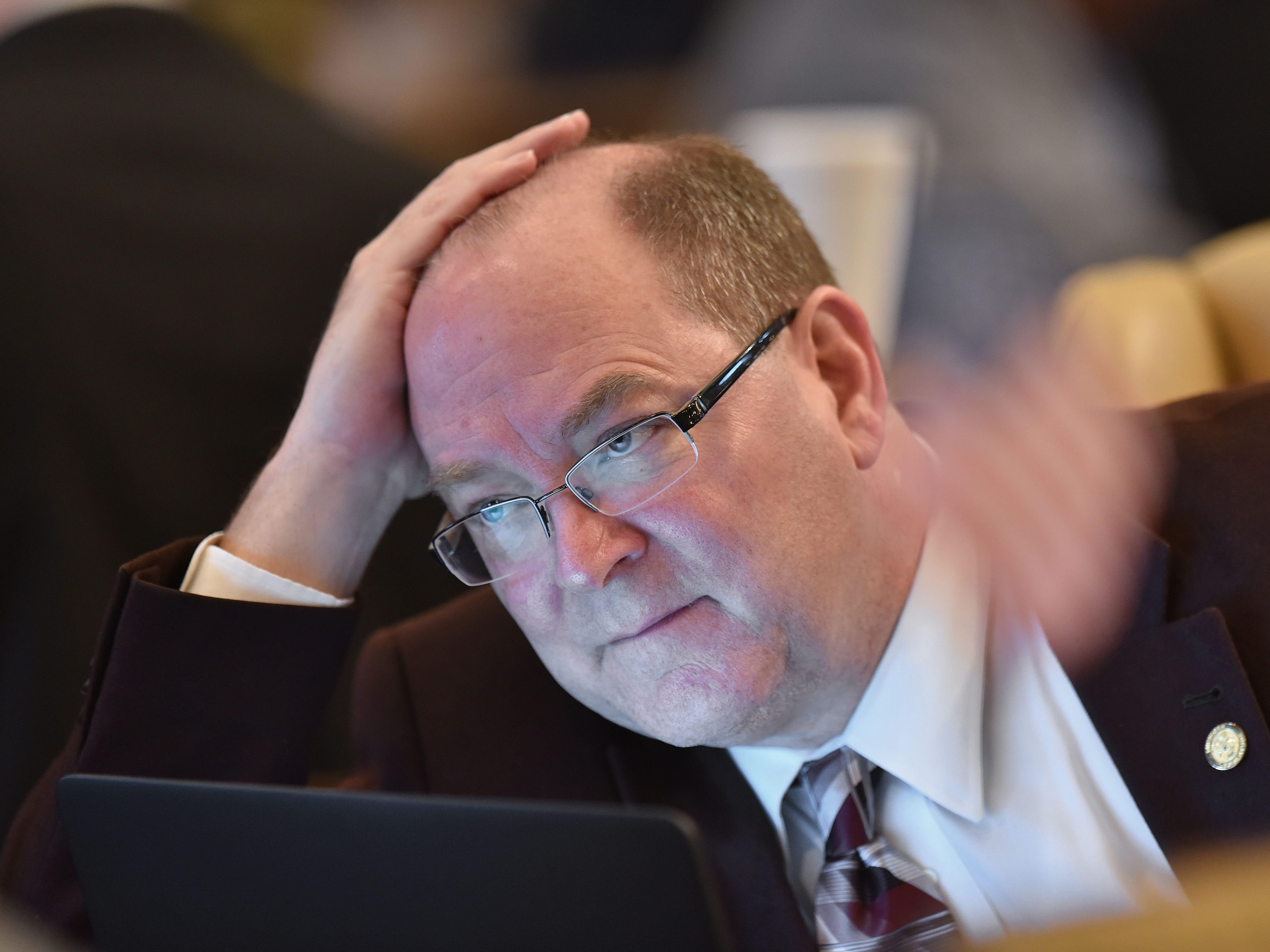 Embezzlement probe clouds GOP senator's campaign finance push