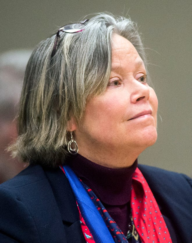 Dr. Eden Wells listens as Genesee District Judge William Crawford reads through a prepared statement during a hearing Friday, Dec. 7, 2018, at Genesee District Court in downtown Flint, Mich.  Wells, Michigan's chief medical executive, will stand trial on involuntary manslaughter and other charges in a criminal investigation of the Flint water crisis, a judge ruled Friday.