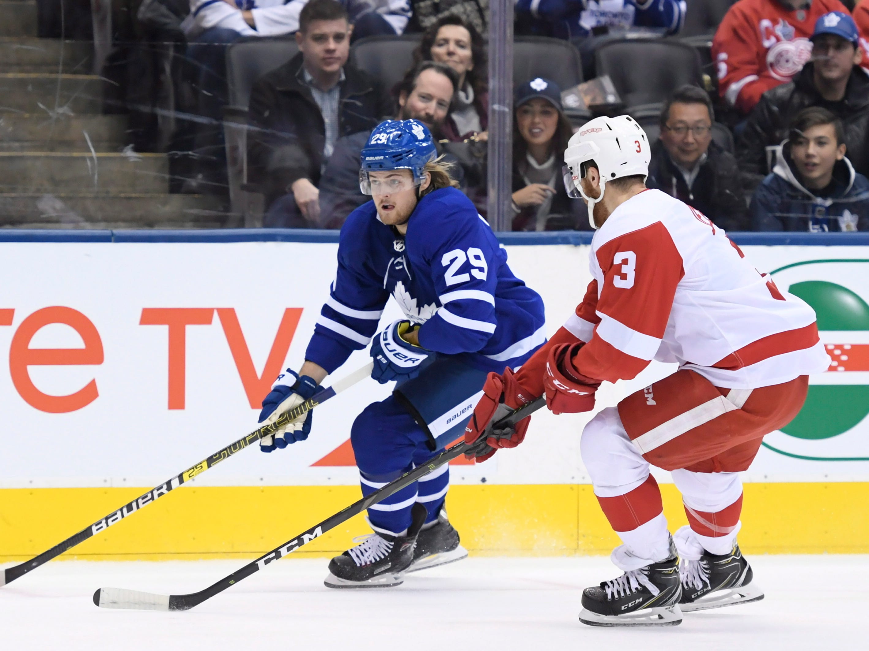 Toronto's William Nylander moves past Detroit defenseman Nick Jensen during the first period.