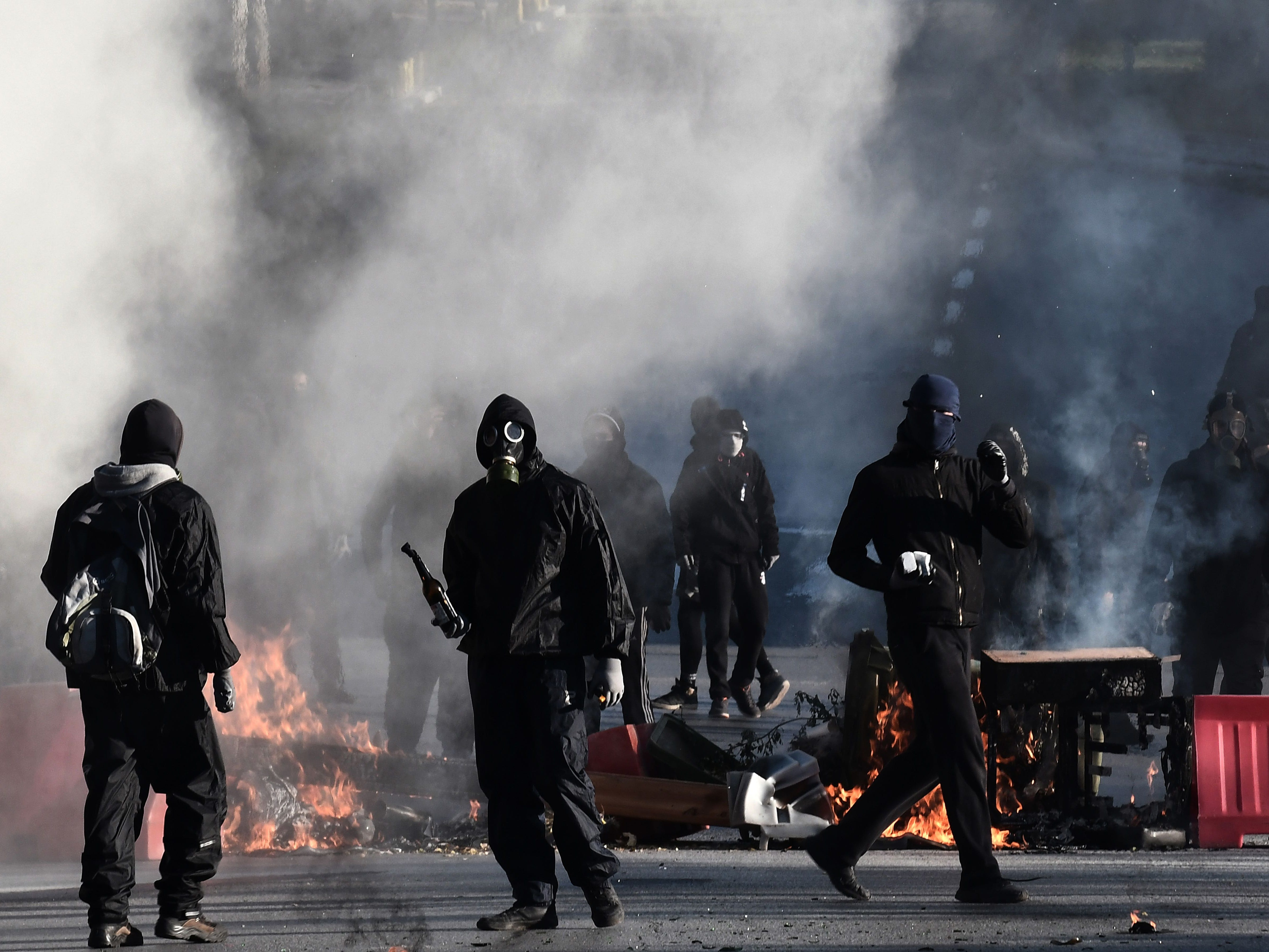 Protesters holding gasoline bombs are seen near barricades during a demonstration in Athens on Dec. 6, 2018 to commemorate the anniversary of the fatal shooting of a teenager which sparked major riots in Greece in 2008.