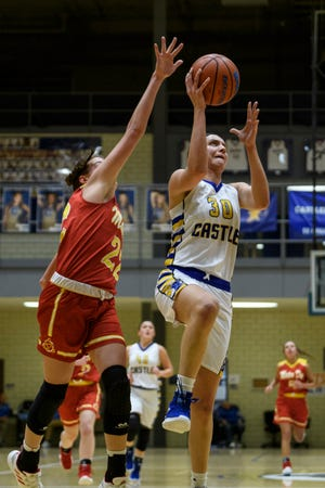 Castle's Jessica Nunge (30) makes a layup as Mater Dei's Jossie Hudson (22) attempts to block her at Castle High School in Newburgh, Ind., Thursday, Dec. 6, 2018. The Knights defeated the Wildcats, 71-35.