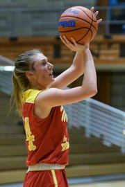 Mater Dei's Kelsey Carr (34) takes a shot against the Castle Knights at Castle High School in Newburgh, Ind., Thursday, Dec. 6, 2018. The Knights defeated the Wildcats, 71-35.