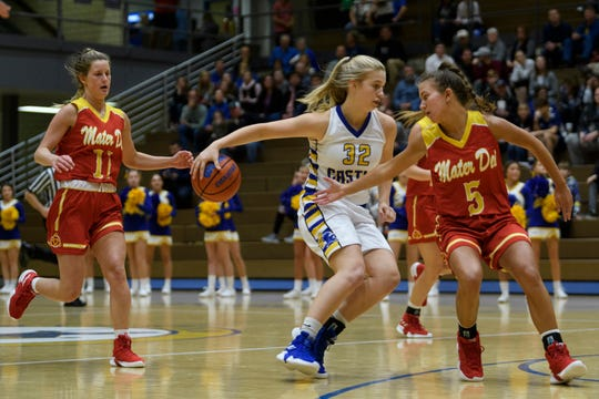 Castle's Natalie Niehaus (32) dribbles around Mater Dei defender Alaina Spahn (5) during the first quarter at Castle High School in Newburgh, Ind., Thursday, Dec. 6, 2018. The Knights defeated the Wildcats, 71-35.
