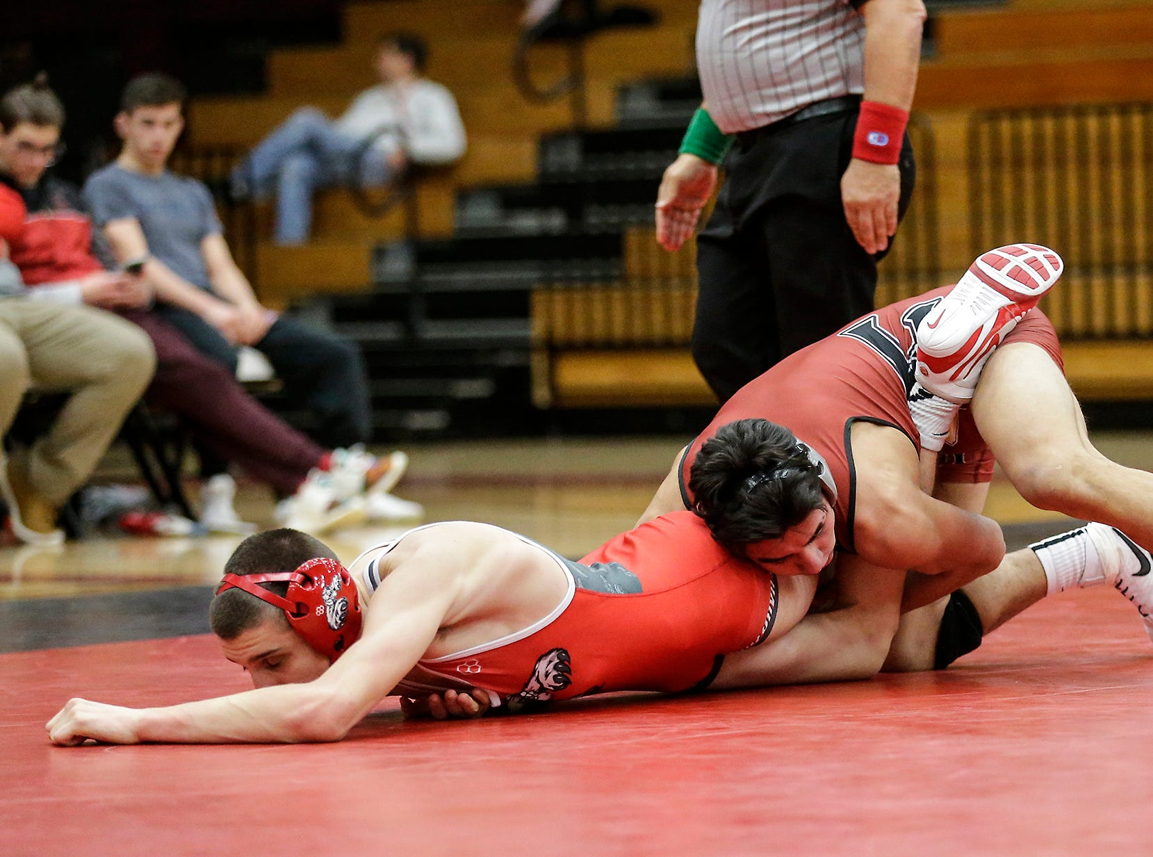 Fond du Lac High School wrestling's Issac Ortegon wrestles against Hortonville High School's Jacob Collar in the 145 weight class during their meet Thrusday, December 6, 2018 in Fond du Lac, Wisconsin. Ortegon won the match with a pin and Fond du Lac won the meet 51-18. Doug Raflik/USA TODAY NETWORK-Wisconsin