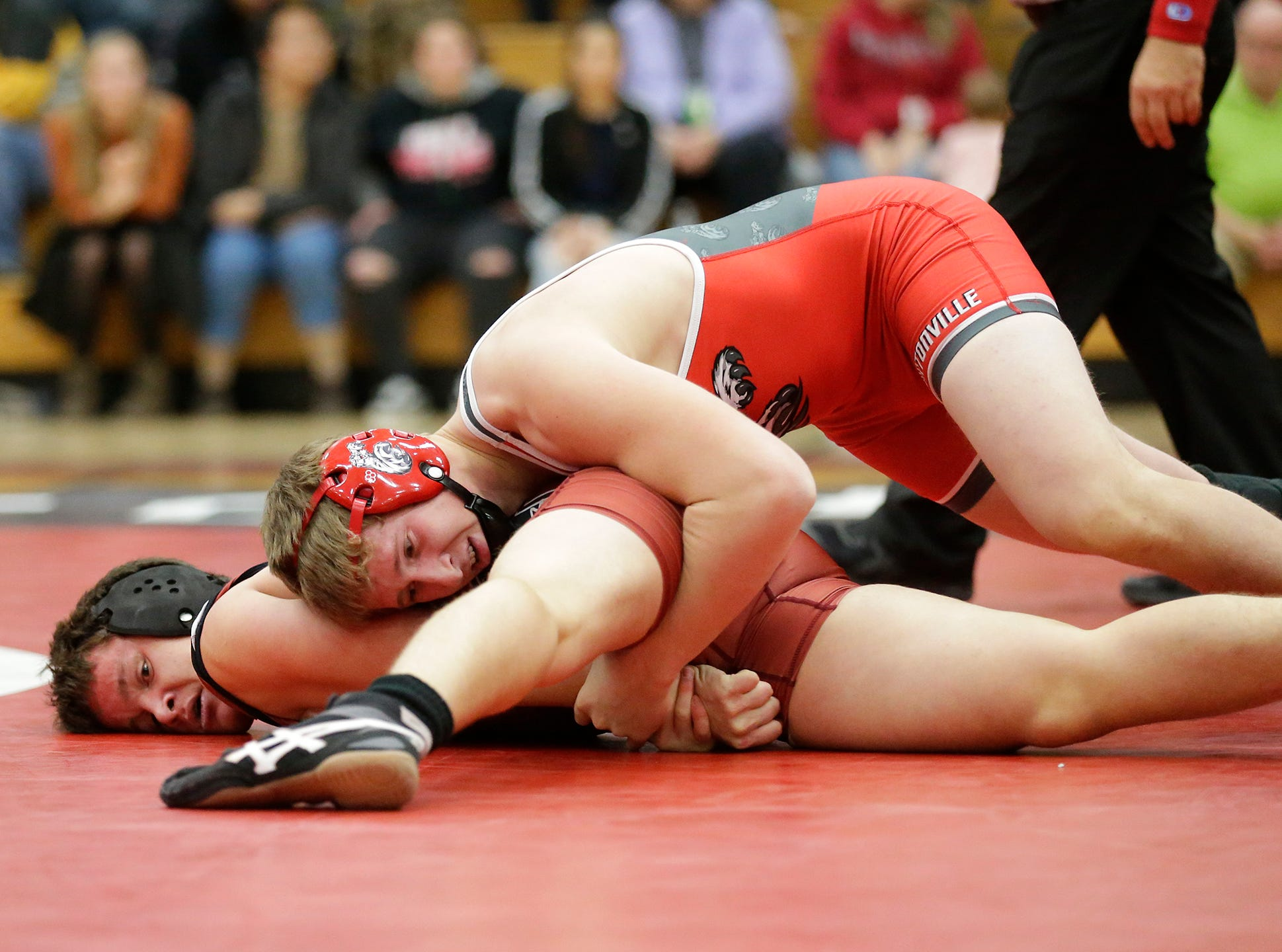 Fond du Lac High School wrestling's Jacob Petrie wrestles against Colin Schuler of Hortonville High School in the 170 weight class during their meet Thrusday, December 6, 2018 in Fond du Lac, Wisconsin. Schuler won the match with a pin and Fond du Lac won the meet 51-18. Doug Raflik/USA TODAY NETWORK-Wisconsin
