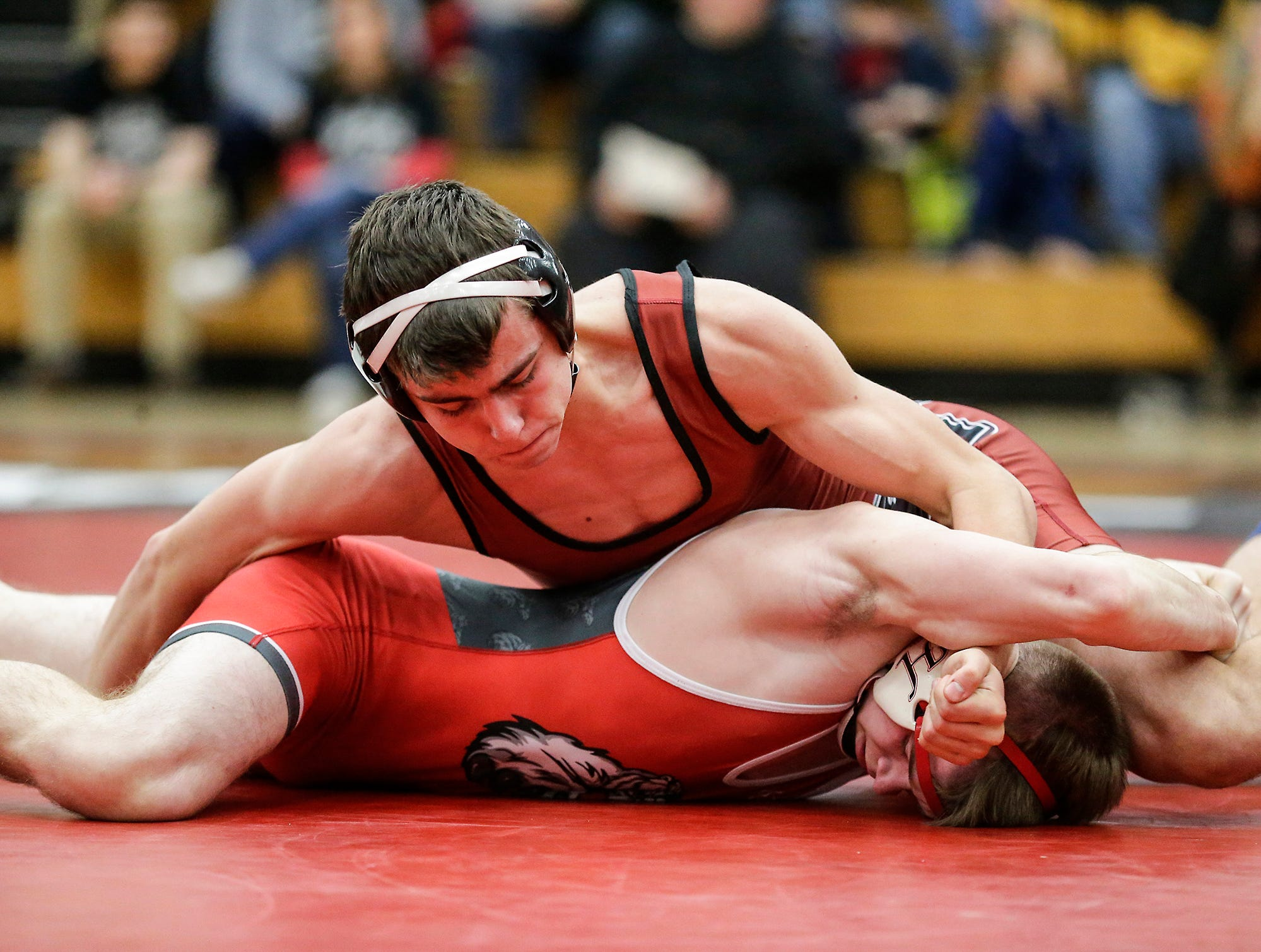 Fond du Lac High School wrestling's Logan Naker wrestles against Hortonville High School's Lucas Shover in the 152 weight class during their meet Thrusday, December 6, 2018 in Fond du Lac, Wisconsin. Naker won the match with a pin and Fond du Lac won the meet 51-18. Doug Raflik/USA TODAY NETWORK-Wisconsin
