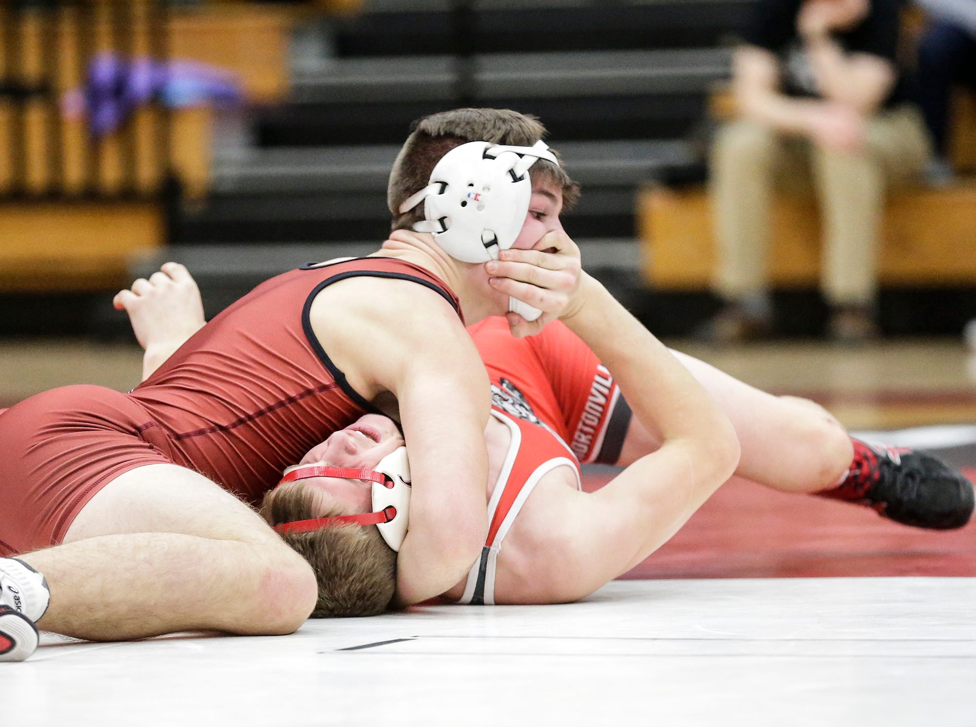 Fond du Lac High School wrestling's Josiah Streblow wrestles against George Huza of Hortonville High School in the 160 weight class during their meet Thrusday, December 6, 2018 in Fond du Lac, Wisconsin. Streblow won the match 11-4 and Fond du Lac won the meet 51-18. Doug Raflik/USA TODAY NETWORK-Wisconsin