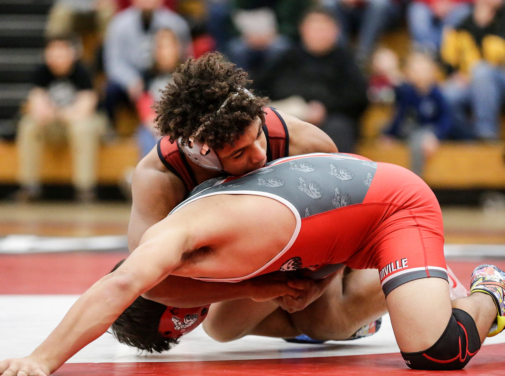 Fond du Lac High School wrestling's Braelon Allen wrestles against Rafino SotoVanCamp of Hortonville High School in the 182 weight class during their meet Thrusday, December 6, 2018 in Fond du Lac, Wisconsin. Allen won the match with a pin and Fond du Lac won the meet 51-18. Doug Raflik/USA TODAY NETWORK-Wisconsin