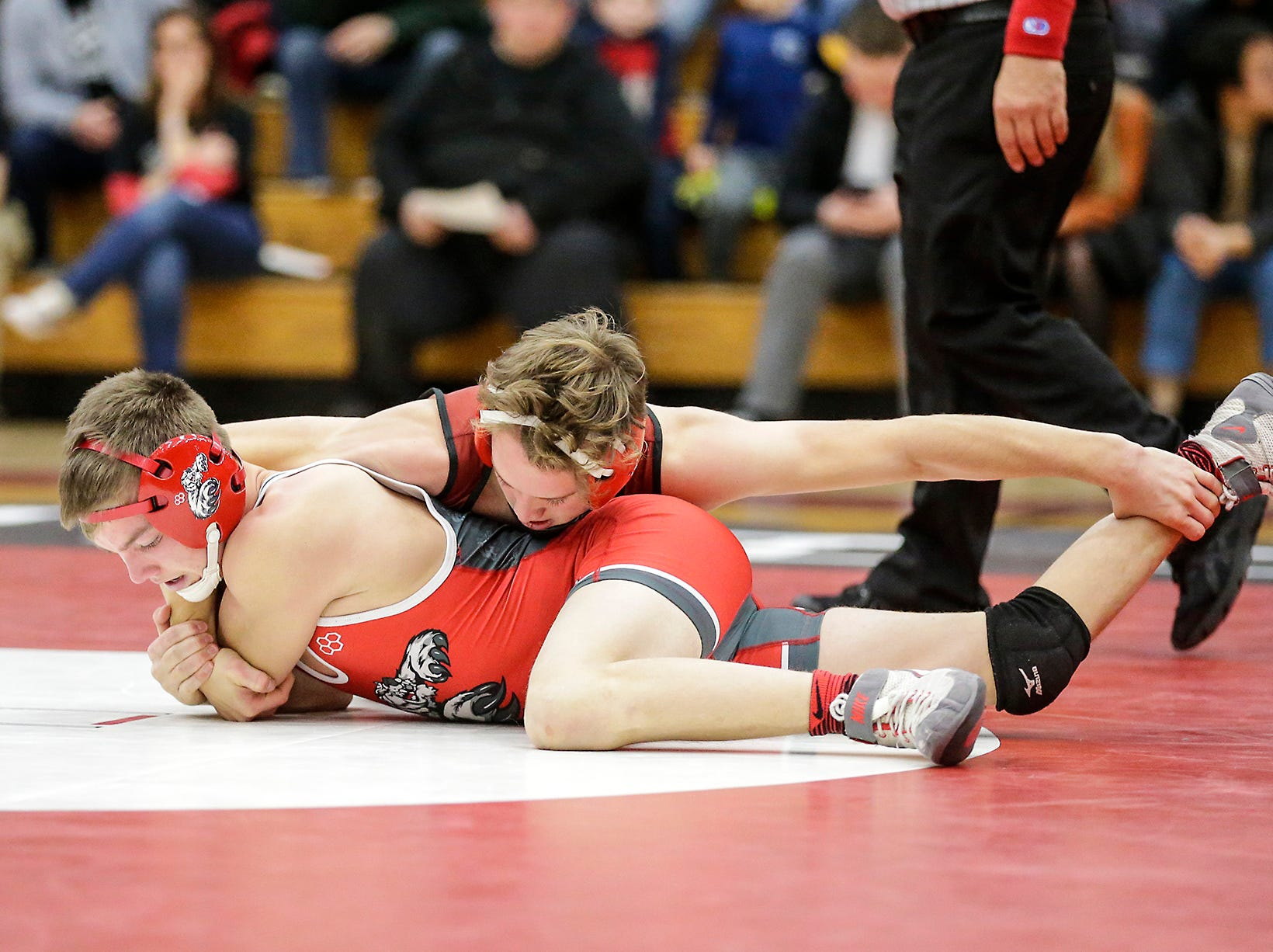 Fond du Lac High School wrestling's Tristan Lakey wrestles against Hortonville High School's Austin Wasmund in the 132 weight class during their meet Thrusday, December 6, 2018 in Fond du Lac, Wisconsin. Lakey won the match with a pin and Fond du Lac won the meet 51-18. Doug Raflik/USA TODAY NETWORK-Wisconsin