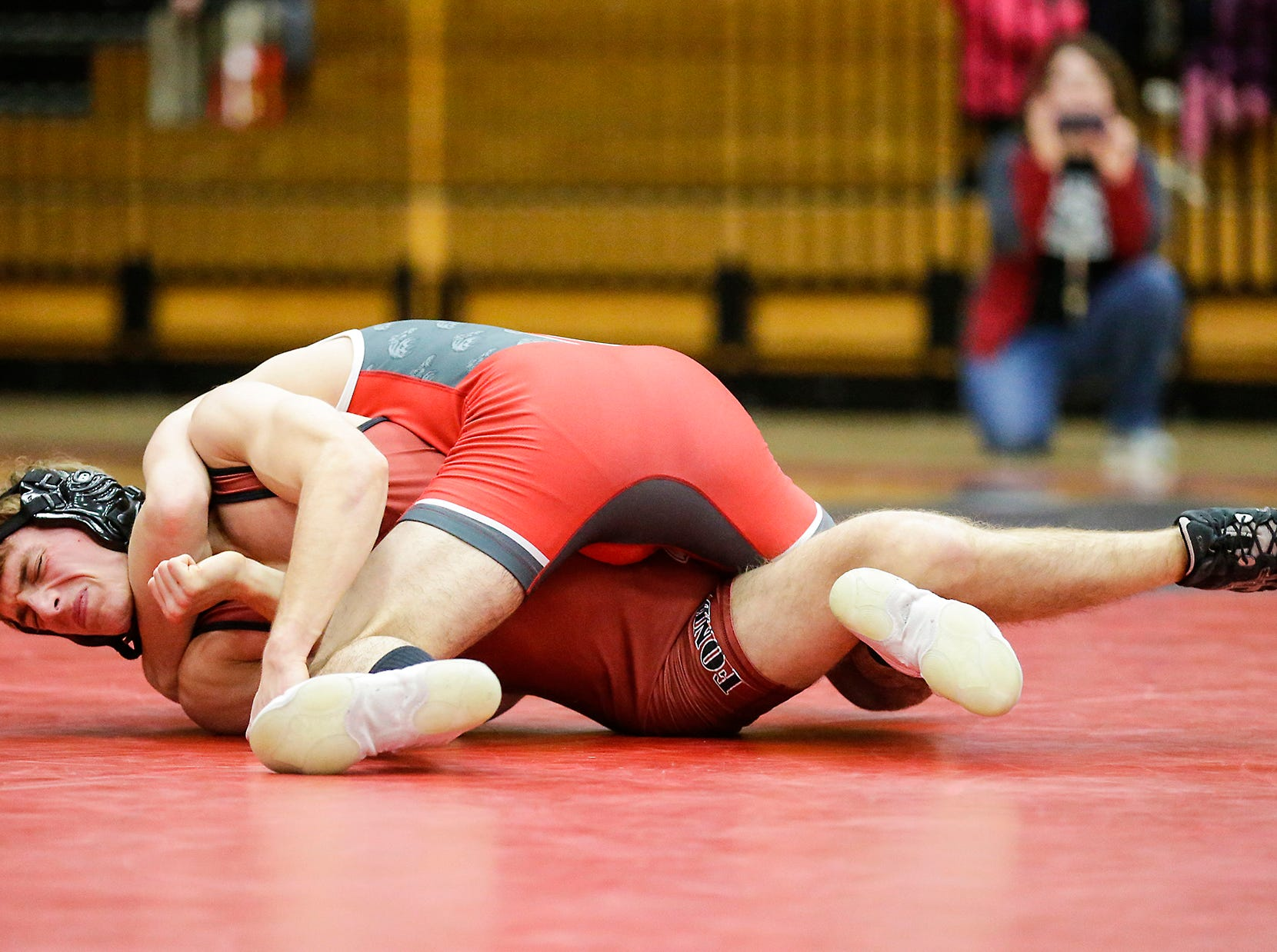 Fond du Lac High School wrestling's Andrew Nehls wrestles against Hortonville High School's Eric Barnett in the 126 weight class during their meet Thrusday, December 6, 2018 in Fond du Lac, Wisconsin. Barnett won the match with a pin and Fond du Lac won the meet 51-18. Doug Raflik/USA TODAY NETWORK-Wisconsin