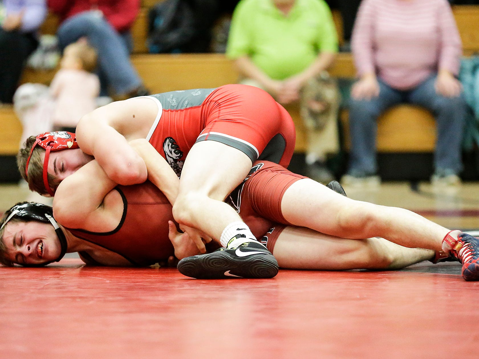 Fond du Lac High School wrestling's Tristan MacDonald wrestles against Hortonville High School's Landon Thern in the 138 weight class during their meet Thrusday, December 6, 2018 in Fond du Lac, Wisconsin. Thern won the match with a pin and Fond du Lac won the meet 51-18. Doug Raflik/USA TODAY NETWORK-Wisconsin