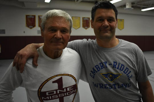 Windsor assistant wrestling coach Milo Trusty, left and son head coach Monte Trusty have helped turn the Wizards into a state wrestling powerhouse.