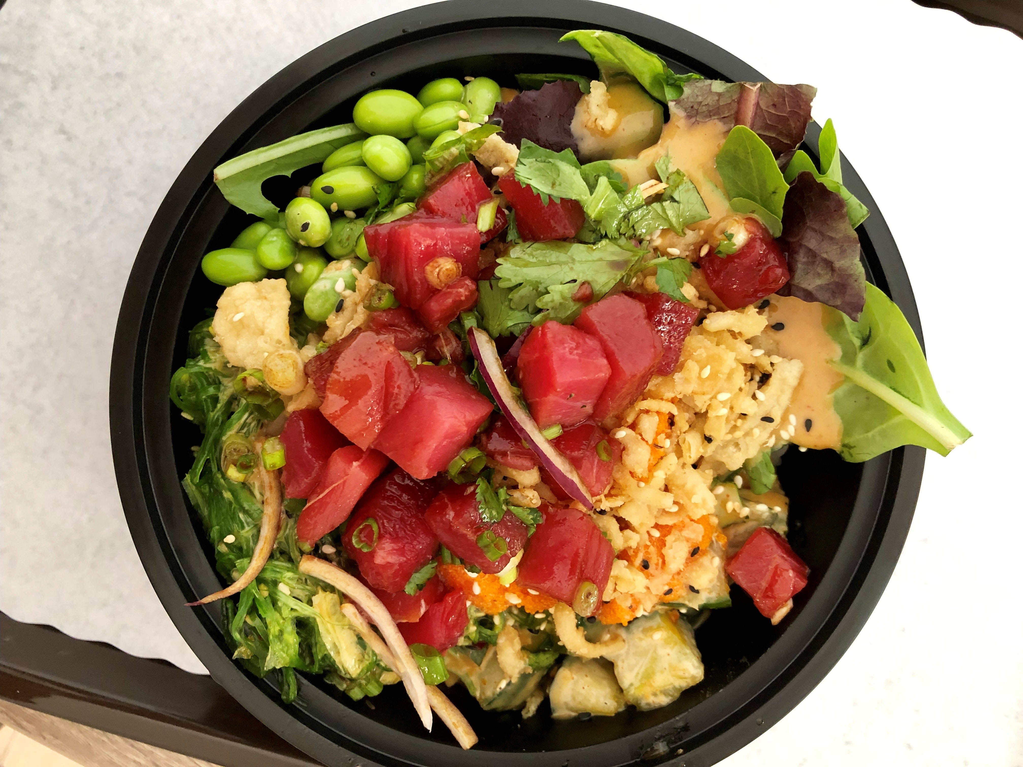 A tuna poke bowl with edamame, spicy cucumbers, seaweed salad, greens and more from PokeBowl Cafe in Fort Myers.