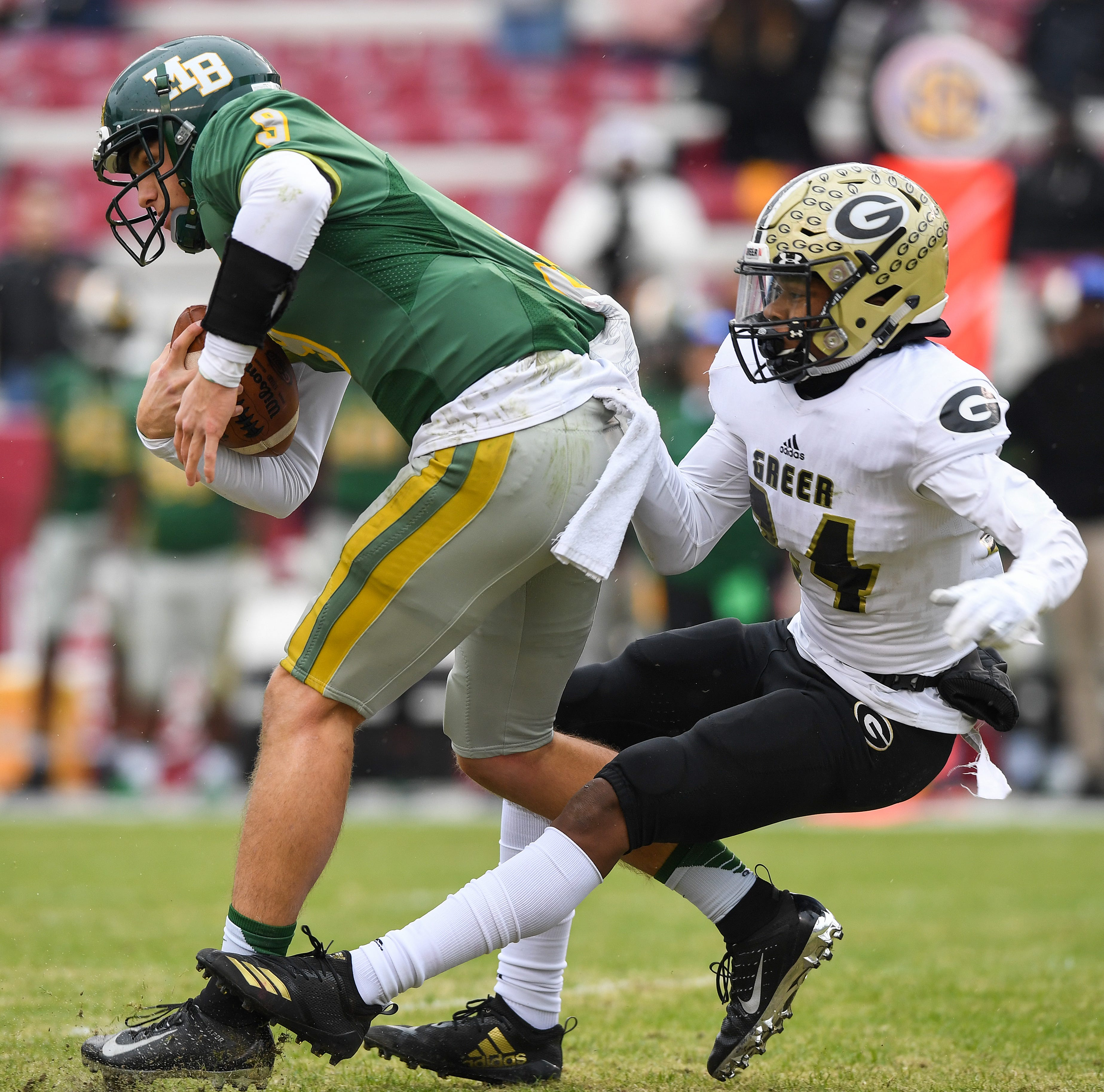 Greer's Najawuan Smith (24) sacks Myrtle Beach quarterback Luke Doty (9) in the class AAAA state finals Friday, December 5, 2018 at Williams Brice Stadium in Columbia.